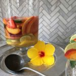 refreshing healthy cocktail with wine and fruit by the culinary cure