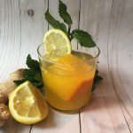 healthy booze cocktail with lemonade and herbs by kristen coffield of the culinary cure