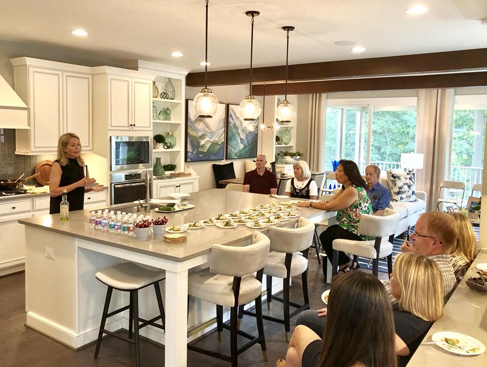 Kristen Coffield hosting an event with Miller and Smith homes