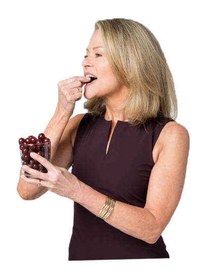 Kristen Coffield enjoying organic grapes